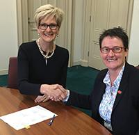 AEU President Meredith Peace and DET Secretary Gill Callister sign the VGSA 2017